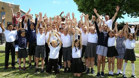 Broadford Primary School pupils and teachers jump for joy following their TES awards success. Pictur