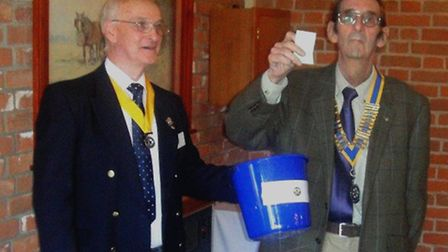 The first photograph shows Philip Hayes, President of Lowestoft Rotary Club, drawing the winning tic