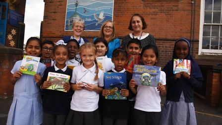 Children from South Park Priamry school celebrate getting their award with Val Carver, head teacher