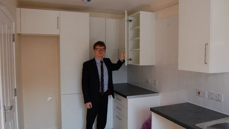 Housing boss Cllr Damian White in the kitchen of a new council house at the Lombard Court developmen