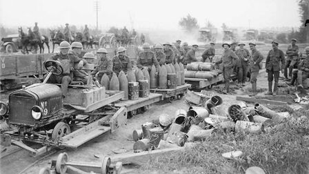 British artillery shells being transported to the guns by light railway. Limbers, cars, carts and a