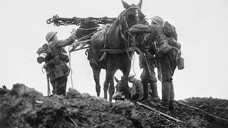 Battle of Pilckem Ridge (opening attack of the Third Battle of Ypres). British troops loading a pack