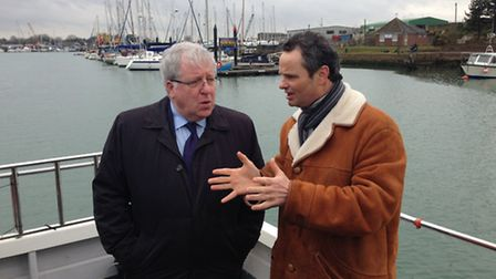 Transport secretary Patrick McLoughlin and Waveney MP Peter Aldous board a boat to take a closer loo