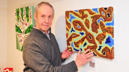 Artist Dennis Read with his textured art work. Picture: Nick Butcher