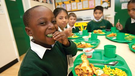 School children at William Davis Primary School enjoying their lunch as part of the Eat for Free pro