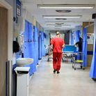 A doctor walking down a hospital ward. Picture: Peter Byrne/PA Archive/PA Images