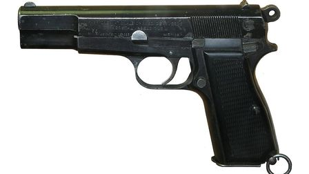 A Browning Hi-Power semi-automatic handgun of the kind smuggled into Praba Banqueting Suite, Ilford, on June 5. Photo...