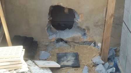 Hole in the wall of the jewellers (Picture: Metropolitan Police)
