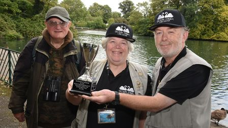 Richard Leighton and Elaine and Tony Webb, of South Park Users Group, with their replica cup honouri