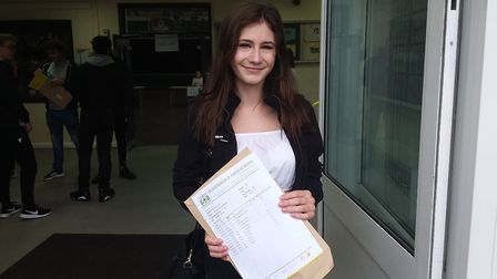 Woodbridge High School pupils celebrating getting their A-level results. Chelsea Brown, 18, who got