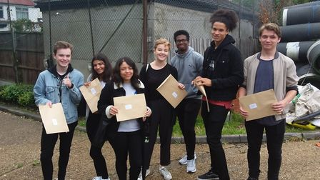 Woodbridge High School pupils celebrating getting their A-level results.