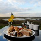 Afternoon tea served at the award-winning RSPB Rainham Cafe featuring a stunning view of the medieva