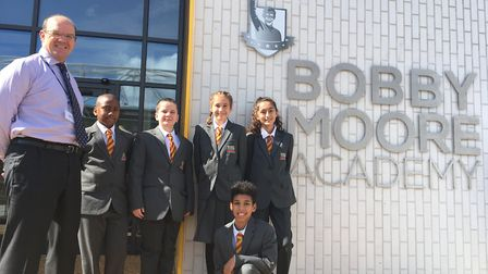 Bobby Moore Academy principal Stuart Burns with some of the school's first pupils (Picture: David Ro