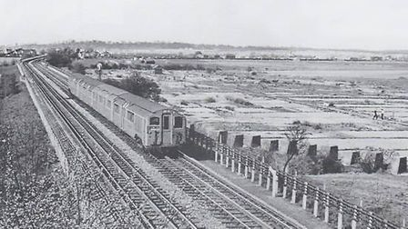 A short Central Line train between Fairlop and Barkingside in April 1955. Note the tank traps and al
