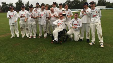 Harold Wood's Bradley Donovan holds aloft the trophy after the Essex Disability Cricket team won the