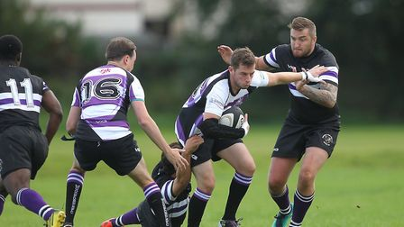 A Woodford player attacks against Romford & Gidea Park (pic George Phillipou/TGS Photo)