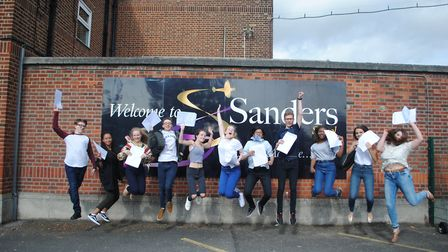 Pupils at Sanders School in Suttons Lane, Hornchurch, celebrating their GCSE exam success. Photo: St