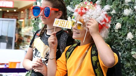 Gabriella Zdanaviciute, left, and best friend Abigail Mickeiute, both 11, dress up for the photoboot
