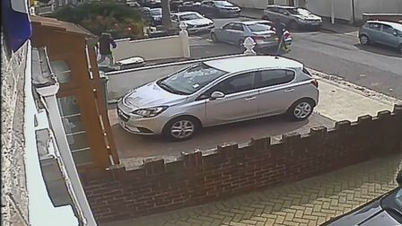 This CCTV footage issued by a neighbour allegedly shows two people entering in and out of the proper