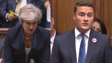 Theresa May, left, responding to Ilford North MP Wes Streeting, right, after his question about the