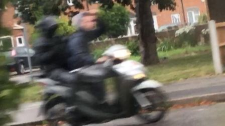 Two people on a moped who allegedly smashed up a vulnerable mum's car with a hammer.