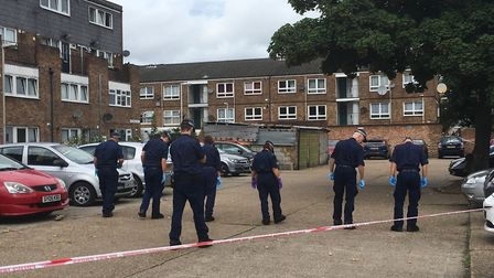 Police sweeping the scene following the double shooting in Moore Walk, Forest Gate