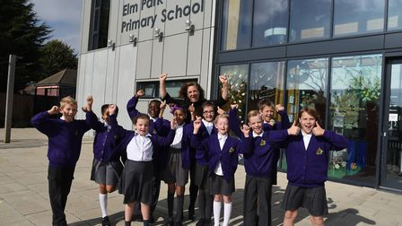 The headteacher of Elm Park Primary School, Victoria Morris, celebrating with pupils after a 'good'