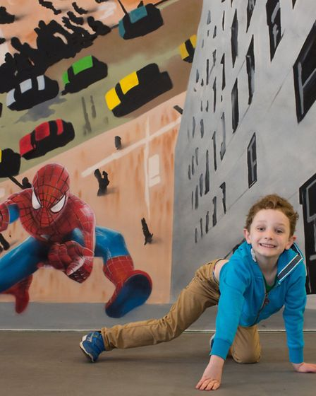Shoppers can have their photo taken against a range of different backgrounds. Picture: The Exchange