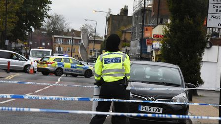 Police and forensic officers at the scene of a shooting near Tom Hood Close, Maryland