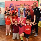 Children at Snaresbrook Primary school enjoying seeing the Premier League cup