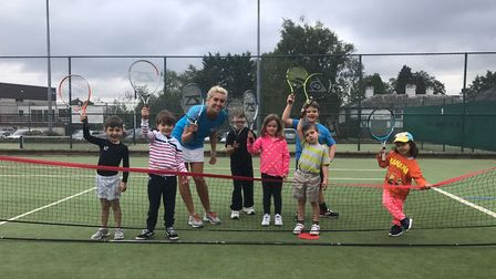 Natasha Argent with some of her young tennis pupils. Picture: Natasha Argent