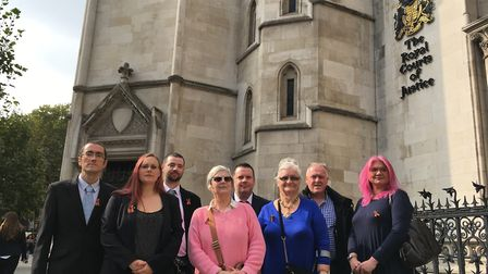 Contaminated blood campaigners outside the Royal Courts of Justice, including Jason Evans (third fro
