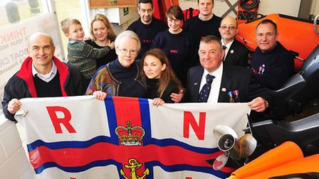 Rebecca Clegg presents the Southwold Lifeboat station with a new weather station in memory of her la