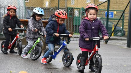 Sylvi Brown from the Redbridge Cycling Centre giving a lesson to nursery children at Mayespark Prima