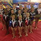 The Havering Gymnasts team face the camera (pic: Havering Gymnasts)