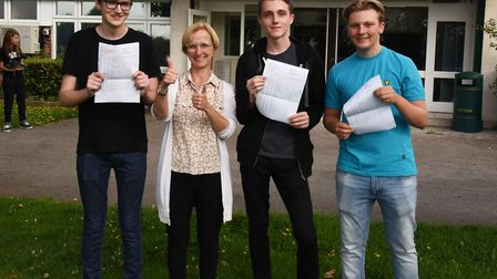 The Albany School celebrating GCSE success. Headteacher Val Masson with Dan Harold, Jack Rice and Ja