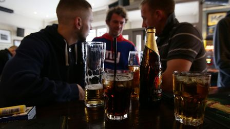 People drinking in a pub. Picture: PA