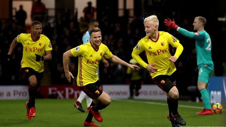 Watford's Will Hughes (right) celebrates scoring his side's first goal of the game during the Premie