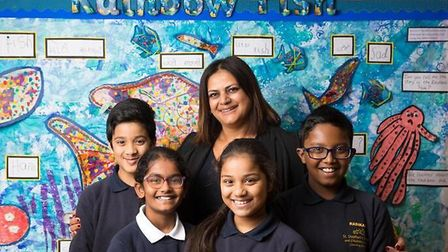 Headteacher Neena Lall with some of her pupils at St. Stephen's Primary School