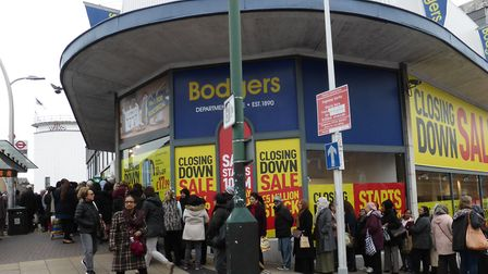 The crowds outside Bodgers, Ilford. Picture: Dharam Sahdev