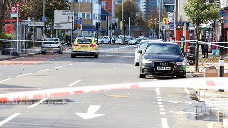 The scene on Ilford High Road after a man, named locally as Sorin Serbu, was beaten to death by a ga