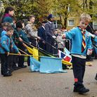 Scattering poppies at Redbridge's main Remembrance commemoration. Picture: Ken Mears