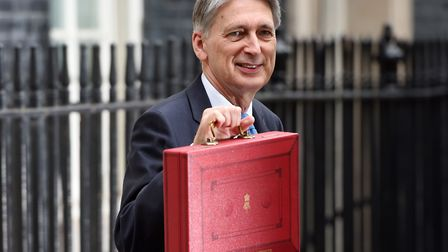 Chancellor Philip Hammond holding his red ministerial box outside 11 Downing Street before heading t