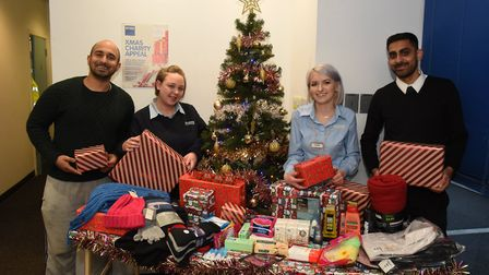 Staff from Access Self Storage with their donation for Hope4Havering. Left to right Devin Chohan, J