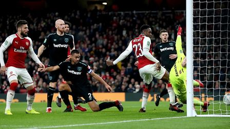 Arsenal's Danny Welbeck (23) scores his side's first goal of the game during the Carabao Cup Quarter