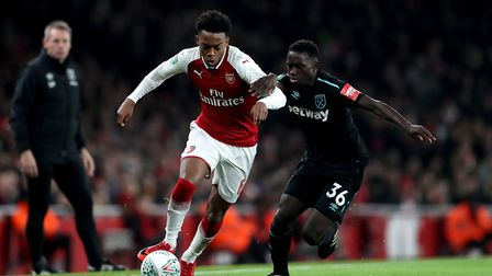 West Ham United's Domingos Quina (right) and Arsenal's Joe Willock (left) battle for the ball during