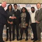 Newham youth group New Choices for Youth are presented with their award by Sir Mike Penning MP