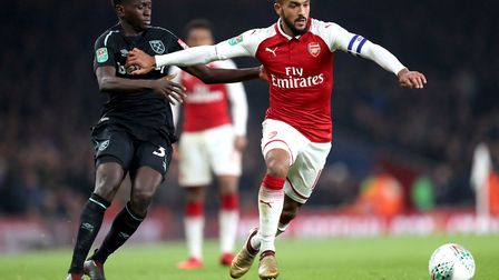 West Ham United's Domingos Quina (left) and Arsenal's Theo Walcott (right) battle for the ball durin