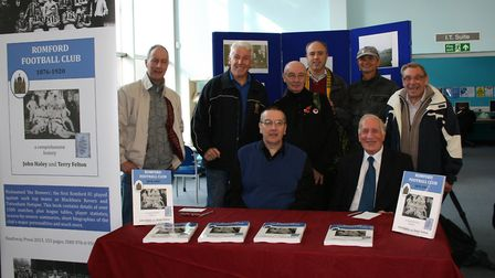 Co-authors Terry Felton and John Haley (seated) at the book signing with Romford fans