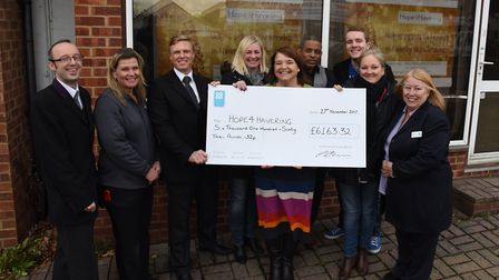 Christopher Saunders from the Co-op handing over a cheque for over £6000 to Hope4Havering